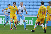 Lee Gregory of Millwall (9) holds the ball up from Ryan Haynes of Coventry City (24) and Nathan Clarke of Coventry City (7) during the EFL Sky Bet League 1 match between Coventry City and Millwall at the Ricoh Arena, Coventry, England on 4 February 2017. Photo by Andy Handley.
