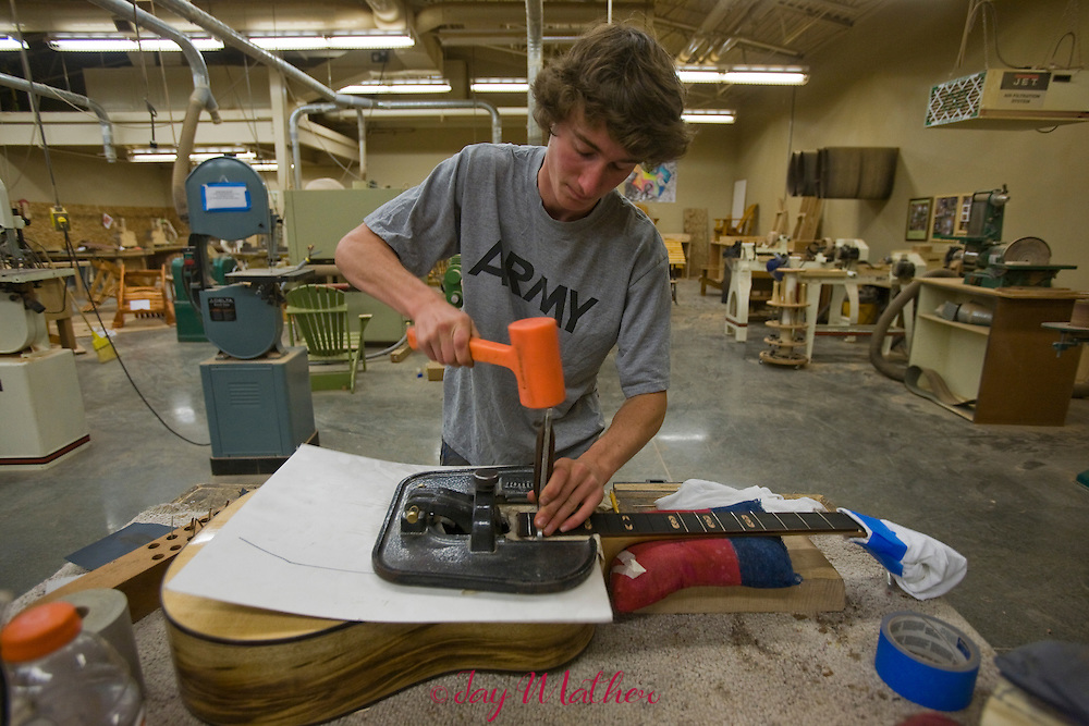 Students in the guitar building program at Sisters High School complete work on guitars they have been building in the wood shop.  Tony Cosby and Bill McDonald are the instructors.