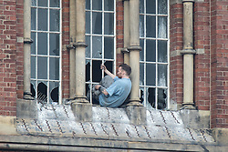 © Licensed to London News Pictures . 15/09/2015 . Manchester , UK . STUART HORNER climbs through windows from inside the rotunda on the roof at HMP Manchester (formerly Strangeways Prison ), this morning (15th September 2015) . Photo credit : Joel Goodman/LNP