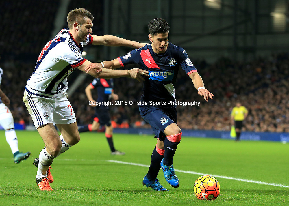 28th December 2015 - Barclays Premier League - West Bromwich Albion v Newcastle United - Ayoze Perez of Newcastle United tries to ghost past Gareth McAuley of West Bromwich Albion - Photo: Paul Roberts / Offside.