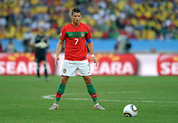 CRISTIANO RONALDO (Portugal) prepares to take a free kick during the 2010 FIFA World Cup South Africa Group G match between Portugal and Brazil at Durban Stadium on June 25, 2010 in Durban, South Africa.