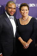 January 12, 2013- Washington, D.C- (L-R) Actor Anthony Anderson and Deb Lee, President, BET Networks attend the 2013 BET Honors Red Carpet held at the Warner Theater on January 12, 2013 in Washington, DC. BET Honors is a night celebrating distinguished African Americans performing at exceptional levels in the areas of music, literature, entertainment, media service and education. (Terrence Jennings)