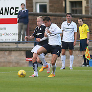Nicky Low battles for the ball with Raith's Ross Callachan - Raith Rovers v Dundee, pre-season friendly at Starks Park<br /> <br />  - &copy; David Young - www.davidyoungphoto.co.uk - email: davidyoungphoto@gmail.com