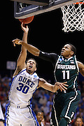 INDIANAPOLIS, IN - MARCH 29: Seth Curry #30 of the Duke Blue Devils drives to the basket past Keith Appling #11 of the Michigan State Spartans during the regional round of the 2013 NCAA Men's Basketball Tournament at Lucas Oil Stadium on March 29, 2013 in Indianapolis, Indiana. (Photo by Joe Robbins)