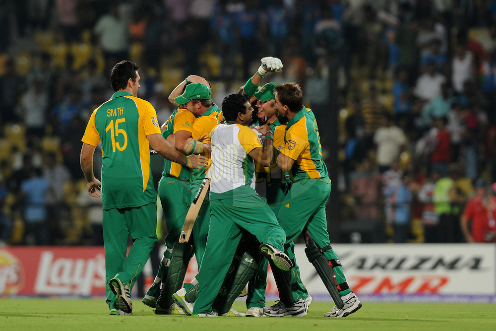 South African team celebrate after the win  during the ICC Cricket World Cup match between India and South Africa held at the Vidarbha Cricket Stadium in Nagpur on the 12 March 2011..Photo by Pal Pillai/BCCI/SPORTZPICS