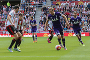 Tottenham Hotspur forward Harry Kane takes on Sunderland Defender John O'Shea during the Barclays Premier League match between Sunderland and Tottenham Hotspur at the Stadium Of Light, Sunderland, England on 13 September 2015. Photo by Simon Davies.
