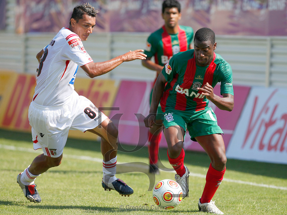 Maritimo player, Baba (L), fights for the ball with Braga opponent, Vandinho (L) , during their first league soccer match held at the Barreiros stadium, Funchal, Madeira Island, Portugal, 13 Setember 2009..Photo Gregorio Cunha.Estadio dos Barreiros, Liga Portuguesa.Maritimo vs Braga.Vandinho e Baba.Foto Gregorio Cunha.