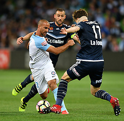 December 17, 2016 - Melbourne, Victoria, Australia - EMMANUEL MUSCAT (2) of Melbourne City and JAMES DONACHIE (17) of the Victory fight for the ball in the round 11 match of the A-League between Melbourne City and Melbourne Victory at AAMI Park, Melbourne, Australia. Victory won 2-1 (Credit Image: © Sydney Low via ZUMA Wire)
