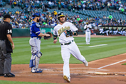 OAKLAND, CA - JULY 15:  Josh Reddick #22 of the Oakland Athletics scores a run past Russell Martin #55 of the Toronto Blue Jays and umpire Mark Wegner #14 during the first inning at the Oakland Coliseum on July 15, 2016 in Oakland, California. (Photo by Jason O. Watson/Getty Images) *** Local Caption *** Josh Reddick; Russell Martin; Mark Wegner