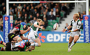 Twickenham, GREAT BRITAIN, Left, Exiles, Peter HEWAT, tackled by George ROBSON and Neil McMILLAN, passes the ball to Shane GERAGHTY, during the EDF Energy Cup rugby match,  Harlequins vs London Irish, at Twickenham Stoop, Surrey on Sat 25.10.2008 [Photo, Peter Spurrier/Intersport-images]