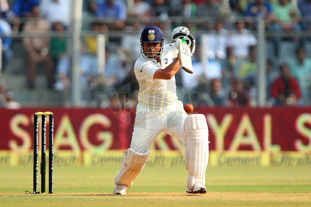 Sachin Tendulkar of India  during day two of the second Star Sports test match between India and The West Indies held at The Wankhede Stadium in Mumbai, India on the 15th November 2013<br /> <br /> This test match is the 200th test match for Sachin Tendulkar and his last for India.  After a career spanning more than 24yrs Sachin is retiring from cricket and this test match is his last appearance on the field of play.<br /> <br /> <br /> Photo by: Ron Gaunt - BCCI - SPORTZPICS<br /> <br /> Use of this image is subject to the terms and conditions as outlined by the BCCI. These terms can be found by following this link:<br /> <br /> http://sportzpics.photoshelter.com/gallery/BCCI-Image-Terms/G0000ahUVIIEBQ84/C0000whs75.ajndY