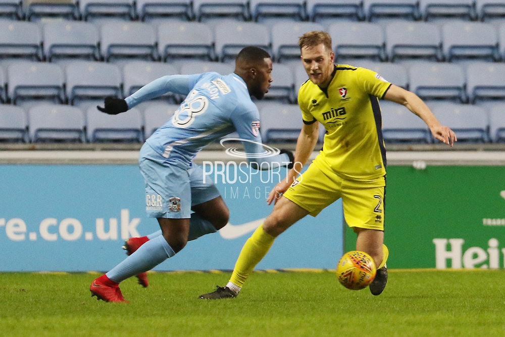 Duckens Nazon and Jamie Grimes during the EFL Sky Bet League 2 match between Coventry City and Cheltenham Town at the Ricoh Arena, Coventry, England on 16 December 2017. Photo by Antony Thompson.
