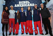 U.S. Freeskiing hopefuls John Teller, Maddie Bowman, Aaron Blunck, Devin Logan and Tom Wallisch, left to right, joined by Jasmin Ghaffarian, far left, and Aaron Carpenter, far right, both of The North Face, unveil the official 2014 U.S. Freeskiing Competition Uniforms, Monday, Oct. 28, 2013, in New York, which will be worn by the United States freeskiing athletes when the sport makes its historic debut in Sochi.  (Photo by Diane Bondareff/Invision for The North Face/AP Images)