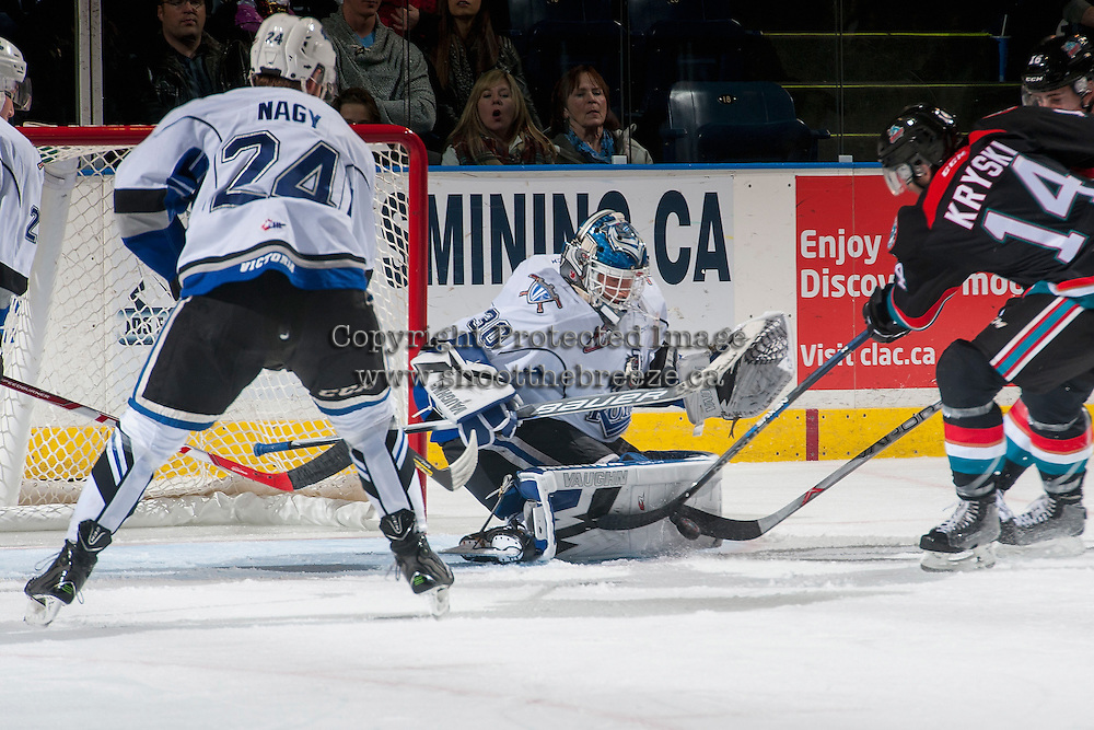 KELOWNA, CANADA - OCTOBER 26: Griffen Outhouse #30 of the Victoria Royals makes a save on a shot by Jake Kryski #14 of the Kelowna Rockets during first period on October 26, 2016 at Prospera Place in Kelowna, British Columbia, Canada.  (Photo by Marissa Baecker/Shoot the Breeze)  *** Local Caption ***