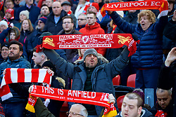 """LIVERPOOL, ENGLAND - Saturday, February 24, 2018: A Liverpool supporter sings """"You'll Never Walk Alone"""" before the FA Premier League match between Liverpool FC and West Ham United FC at Anfield. (Pic by David Rawcliffe/Propaganda)"""