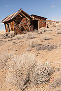 Old abandoned buildings in former gold mining boomtown turned ghost town Goldfield, Nevada, USA