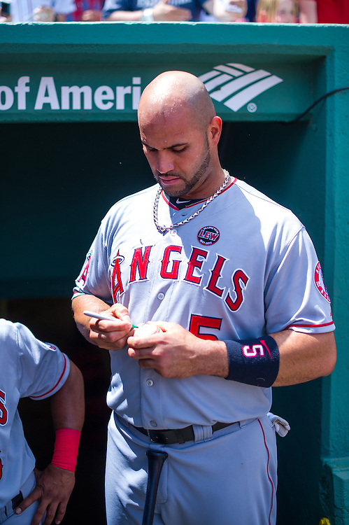 BOSTON, MA - JUNE 09: Albert Pujols #5 of the Los Angeles Angels signs an autograph before the game against the Boston Red Sox at Fenway Park in Boston, Massachusetts on June 9, 2013. (Photo by Rob Tringali) *** Local Caption *** Albert Pujols