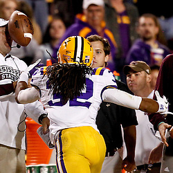 November 10, 2012; Baton Rouge, LA, USA;  A deflected pass hits Mississippi State Bulldogs head coach Dan Mullen as LSU Tigers cornerback Jalen Collins (32) makes an attempt to catch the ball during the second half of a game at Tiger Stadium.  LSU defeated Mississippi State 37-17. Mandatory Credit: Derick E. Hingle-US PRESSWIRE