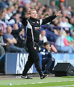 Bolton Wanderers First Team Manager Neil Lennon arms in the air during the Sky Bet Championship match between Bolton Wanderers and Brighton and Hove Albion at the Macron Stadium, Bolton, England on 26 September 2015.