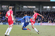 Matty Pearson of Accrington Stanley FC and Lyle Taylor of AFC Wimbledon stretch for the ball during the Sky Bet League 2 match between AFC Wimbledon and Accrington Stanley at the Cherry Red Records Stadium, Kingston, England on 5 March 2016. Photo by Stuart Butcher.