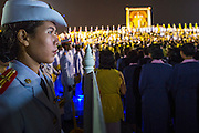 05 DECEMBER 2012 - BANGKOK, THAILAND:  A Thai naval cadet stands at attention in front of the dais for the King during the public ceremony to celebrate the birthday of Bhumibol Adulyadej, the King of Thailand, on Sanam Luang, a vast public space in front of the Grand Palace in Bangkok Wednesday night. The King celebrated his 85th birthday Wednesday and hundreds of thousands of Thais attended the day long celebration around the Grand Palace and the Royal Plaza, north of the Palace. The Thai monarch is revered by most Thais as unifying force in Thailand's society, which is not yet recovered from the political violence of 2010.     PHOTO BY JACK KURTZ