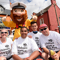 REPRO FREE<br /> RNLI Mascot 'Stormy Stan' with the crew of the 'Baggy II' raft, Andrea Moriarty, Temba Jere, Ethan Monkhouse and Daragh Keating, at start of the RNLI Raft Race in Kinsale on Saturday of the Bank Holiday Weekend<br /> Picture. John Allen
