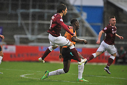 Northamptons Ricky Holmes trys a shot past Barnets John Akinde,Northampton Town v Barnet FC, Sixfields Stadium, Sky Bet League Two, Saturday 2nd January 2016, Score 3-0 (Hoskins,Holmes, Richards)