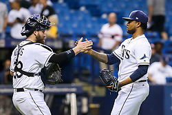 June 7, 2017 - St. Petersburg, Florida, U.S. - WILL VRAGOVIC   |   Times.Tampa Bay Rays catcher Derek Norris (33) high fives relief pitcher Alex Colome (37) after the game between the Tampa Bay Rays and the Chicago White Sox at Tropicana Field in St. Petersburg, Fla. on Wednesday, June 7, 2017. The Tampa Bay Rays beat the Chicago White Sox 3-1. (Credit Image: © Will Vragovic/Tampa Bay Times via ZUMA Wire)