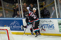 KELOWNA, CANADA - NOVEMBER 28: 26\ checks a player of the Vancouver Giants behind the net during first period on November 28, 2018 at Prospera Place in Kelowna, British Columbia, Canada.  (Photo by Marissa Baecker/Shoot the Breeze)