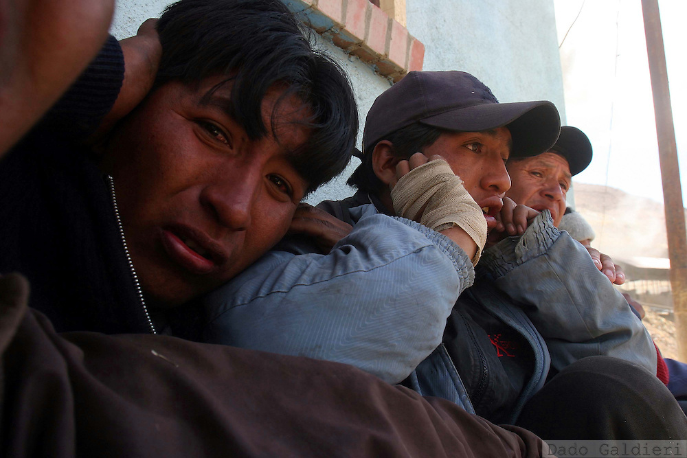 State-employed miners take cover from dynamite thrown by independent miners trying to take control of a facility in the city of Huanuni, some 290 kilometers southeast of capital La Paz, Bolivia on Friday, Oct. 6, 2006.The Bolivian government is sending 700 additional police to the quell a clash between rival bands of miners over one of South America's richest tin mines. Officials say at least 11 people have been killed and more than 50 injured.There were no reports of renewed conflict Friday, but both sides continued to detonate dynamite and homemade explosives, with the blasts echoing across the barren mountain looming above this small mining town 290 kilometers (180 miles) south of the capital of La Paz.(AP Photo/Dado Galdieri)