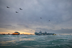 © Licensed to London News Pictures. 16/08/2017. Portsmouth, UK. The Royal Navy's new aircraft carrier HMS Queen Elizabeth enters her home port of Portsmouth for the first time. The new ship at 65,000 tonnes is the biggest warship ever built in the UK. Photo credit: Peter Macdiarmid/LNP