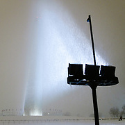 Washington Monument obscured by snow in the middle of a snowstorm at night