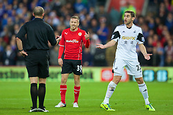 CARDIFF, WALES - Sunday, November 3, 2013: Cardiff City's Craig Bellamy clashes with Swansea City's Angel Rangel during the Premiership match at the Cardiff City Stadium. (Pic by David Rawcliffe/Propaganda)