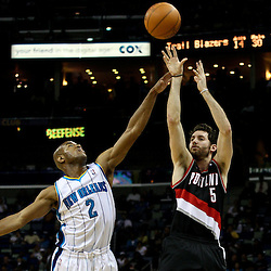 March 30, 2011; New Orleans, LA, USA; Portland Trail Blazers shooting guard Rudy Fernandez (5) shoots over New Orleans Hornets point guard Jarrett Jack (2) during the third quarter at the New Orleans Arena. The Hornets defeated the Trail Blazers 95-91.   Mandatory Credit: Derick E. Hingle