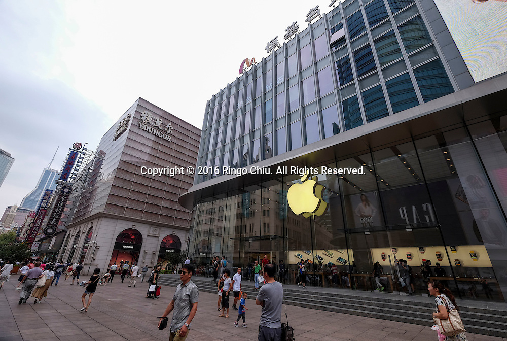 "An Apple Store in the Nanjing Road Pedestrian Street on September 5, 2016, in Shanghai, China. Nanjing Road is the main shopping street of Shanghai, China, and is one of the world's busiest shopping streets. The street is named after the city of Nanjing, capital of Jiangsu province neighbouring Shanghai. Today's Nanjing Road comprises two sections, Nanjing Road East and Nanjing Road West. In some contexts, ""Nanjing Road"" refers only to what was pre-1945 Nanjing Road, today's Nanjing Road East, which is largely pedestrianised. Before the adoption of the pinyin romanisation in the 1950s, its name was rendered as Nanking Road in English. Shanghai is the most populous city in China and the most populous city proper in the world. It is one of the four direct-controlled municipalities of China, with a population of more than 24 million as of 2014. It is a global financial centre, and a transport hub with the world's busiest container port. Located in the Yangtze River Delta in East China, Shanghai sits on the south edge of the mouth of the Yangtze in the middle portion of the Chinese coast. The municipality borders the provinces of Jiangsu and Zhejiang to the north, south and west, and is bounded to the east by the East China Sea. A major administrative, shipping, and trading town, Shanghai grew in importance in the 19th century due to trade and recognition of its favourable port location and economic potential. The city was one of five forced open to foreign trade following the British victory over China in the First Opium War while the subsequent 1842 Treaty of Nanking and 1844 Treaty of Whampoa allowed the establishment of the Shanghai International Settlement and the French Concession. The city then flourished as a center of commerce between China and other parts of the world (predominantly Western countries), and became the primary financial hub of the Asia-Pacific region in the 1930s. However, with the Communist Party takeover of the mainland in 1949, trade was limi"