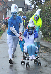 © Licensed to London News Pictures.01/01/2018<br /> SUTTON VALENCE, UK.<br /> SMURFS TEAM RACING.<br /> The traditional New Years day Sutton Valence Pram Race in Kent continued this year. In its 38th year the Race was struck by tragedy last year when competitor Francis 'Titch' O' Sullivan tipped over in his spitfire pram and hit his head on the curb, he passed away a day later. A coroners court reported he was not wearing a helmet.<br />  All babies in the pram's have to wear a helmet and the pushers must have contact with the pram and the ground at all times.<br />  <br /> Photo credit: Grant Falvey/LNP