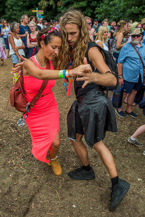 A couple practice their tango moves as Katherine Jenkins sings on the Waterfront stage in front of a large crowd - The 2017 Latitude Festival, Henham Park. Suffolk 16 July 2017