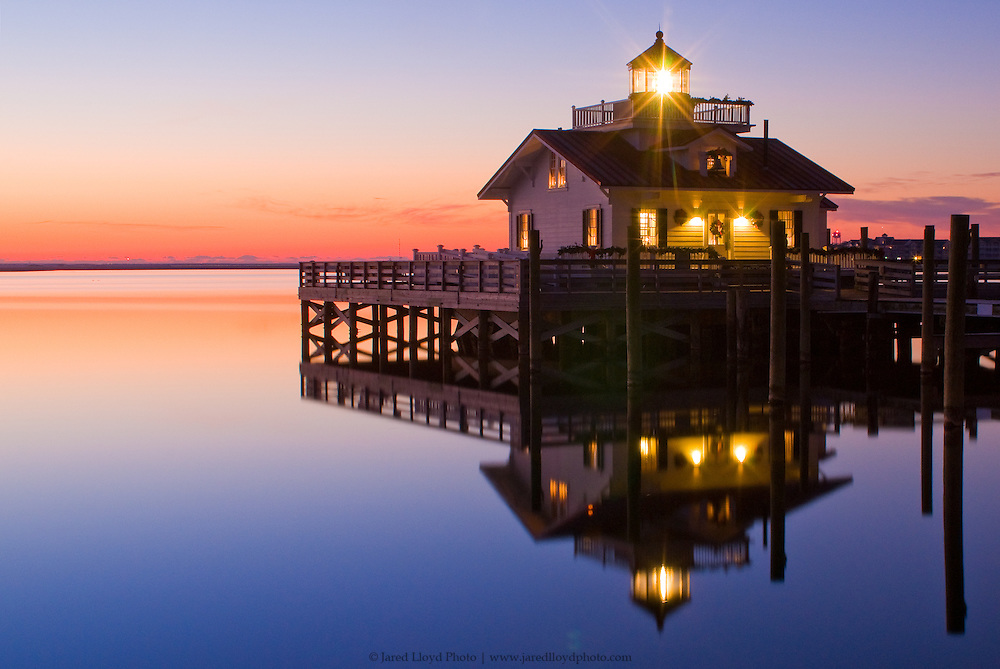 Roanoke Marshes Light shining bright at dawn