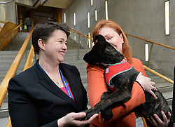 Pictured: MSP Emma Harper and Scottish Conservative leader Ruth Davidson with 14 week old Akita mastiff cross Kai.<br /> <br /> An MSP has launched a bid to have so called puppy farms in Scotland banned.<br /> <br /> © Dave Johnston/ EEm
