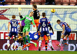 Jakob Haugaard of Wigan Athletic goes up for a corner and challenges for a header - Mandatory by-line: Matt McNulty/JMP - 03/02/2017 - FOOTBALL - DW Stadium - Wigan, England - Wigan Athletic v Sheffield Wednesday - Sky Bet Championship