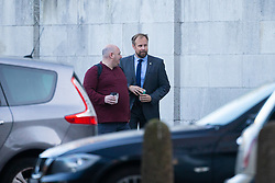 Met police officer Oliver Darby, right, arrives at Inner London Crown Court where he faces charges of voyuerism after allegedly spying on a female police officer in the shower. London, November 30 2018.