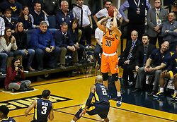 Feb 10, 2018; Morgantown, WV, USA; Oklahoma State Cowboys guard Jeffrey Carroll (30) shoots a three pointer from the corner during the first half against the West Virginia Mountaineers at WVU Coliseum. Mandatory Credit: Ben Queen-USA TODAY Sports