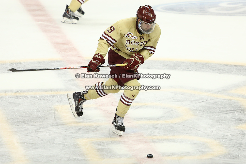 Brendan Silk #9 of the Boston College Eagles skates to the puck during The Beanpot Championship Game at TD Garden on February 10, 2014 in Boston, Massachusetts. (Photo by Elan Kawesch)