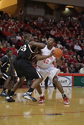22 December 2009: George Akpele elbow blocks Dinma Odiakosa deep in the lane. The Tigers of Grambling State are defeated by the Redbirds of Illinois State 80-56 on Doug Collins Court inside Redbird Arena in Normal Illinois.