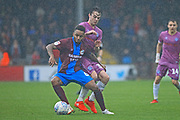 Matty Gillam challenges for the ball during the EFL Sky Bet League 1 match between Scunthorpe United and Rochdale at Glanford Park, Scunthorpe, England on 8 September 2018.
