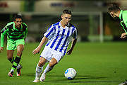 Cheltehham Town's Billy Waters runs forward during the Gloucestershire Senior Cup match between Forest Green Rovers and Cheltenham Town at the New Lawn, Forest Green, United Kingdom on 20 September 2016. Photo by Shane Healey.