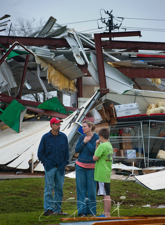 Mackie Hale, Nancy Hale, and Joseph-Luke Hale stand in front of the wreckage of a BP gas station March 9, 2011 in Theodore, Ala. The gas station and the family's produce stand nearby were among several structures heavily damaged when a tornado moved through the area around 9 a.m. Wednesday morning. Three people were injured, and 17,000 residents were left without power following the storm. (Photo by Carmen K. Sisson/Cloudybright)