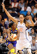 Sep 21, 2013; Phoenix, AZ, USA; Los Angeles Sparks forward Nneka Ogwumike (30) is guarded by Phoenix Mercury center Brittney Griner (42) in  Game 2 of a WNBA basketball Western Conference semifinal series at US Airways Center. The Sparks defeated the Mercury 82-73. Mandatory Credit: Jennifer Stewart-USA TODAY Sports