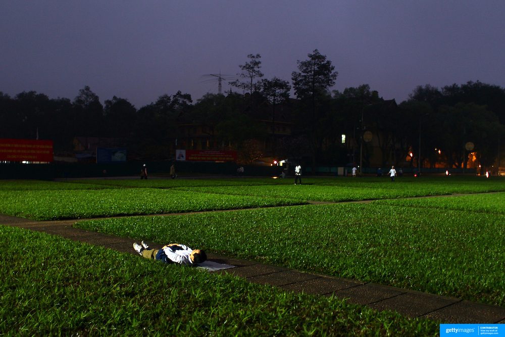 Early morning exercise near The Ho Chi Minh Mausoleum in the centre of Ba Dinh Square. Hanoi, Vietnam.. For a county not know for it's sporting prowess, Hanoi, Vietnam's capital, appears to be gripped in a fitness frenzy. Before 6am street corners, parks and lake sides are a hive of activity as keep fit classes, Tai chi and personal exercise regimes are seen in abundance around the city. Particularly noticeable are Women's keep fit classes, often accompanied by loud poor quality western disco beat music as the occupants of the city get fit come rain or shine. Hanoi, Vietnam. 18th March 2012. Photo Tim Clayton