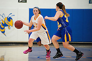Milton's Kate Rowley (14) dribbles the ball down the court during the girls basketball game between Lamoille and Milton at Milton High School on Friday night December 18, 2015 in Milton, (BRIAN JENKINS/for the FREE PRESS)